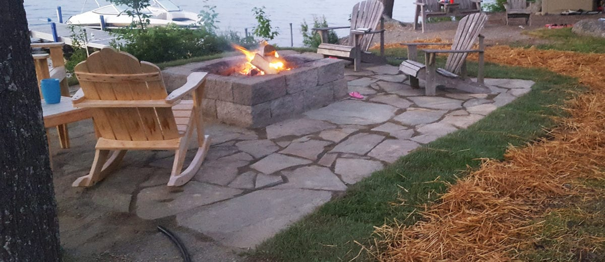 exterior photo of stone patio with firepit